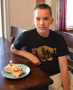 Trevor's all time favorite -  cinnamon rolls - and a happy birthday song to start the day