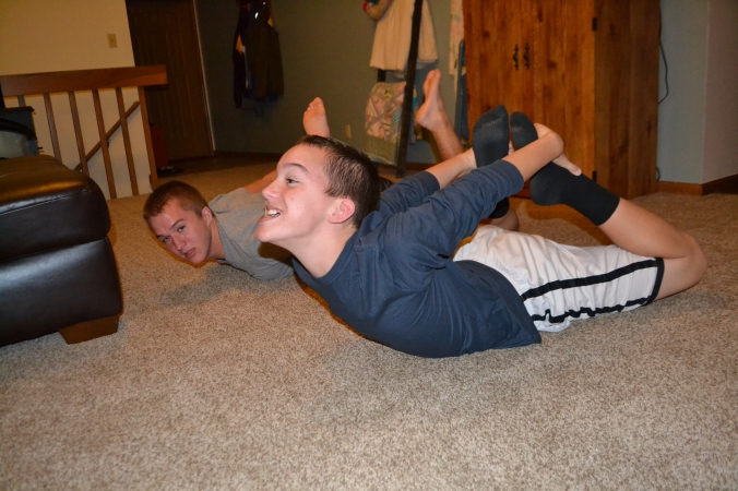 And what do the other boys do during present and card opening?  Goof off of course!  Lesson of the day - Brad is not as flexible as Trevor :)